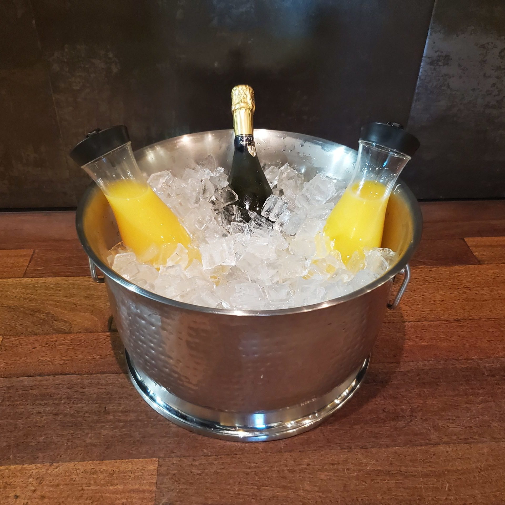 Hammered Steel Bowl filled with Sparkling Wine, Juice and Ice, offered at downtown St. Pete, Florida venue NOVA 535