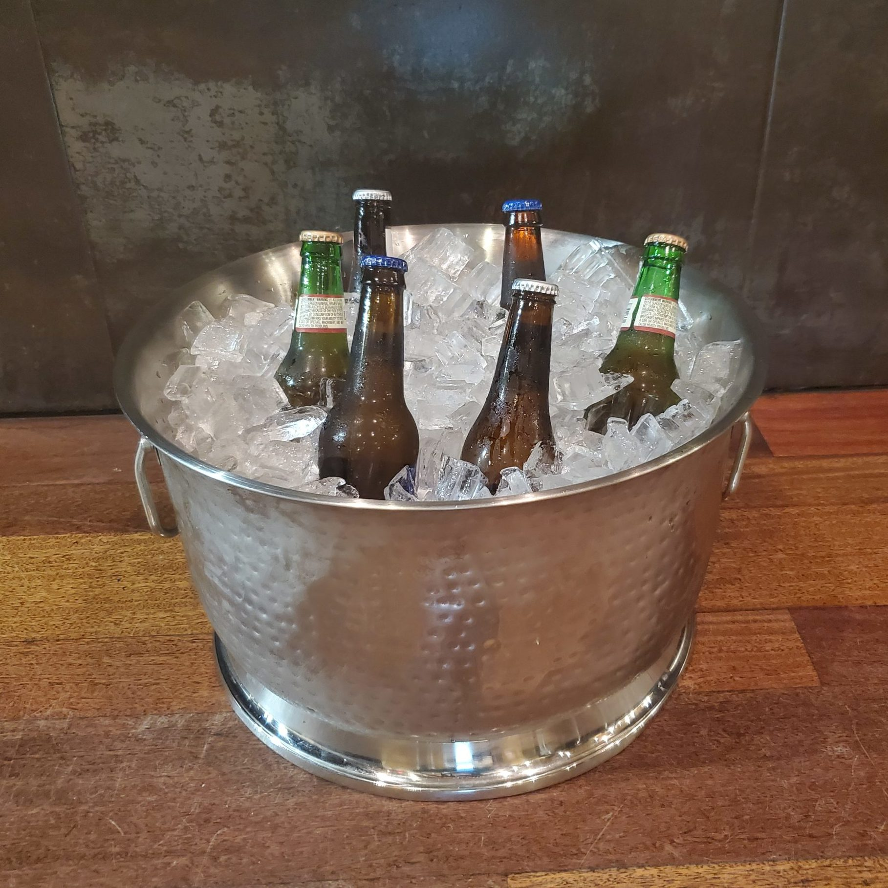 Hammered Steel Bowl filled with House Beers and Ice, offered at downtown St. Pete, Florida venue NOVA 535